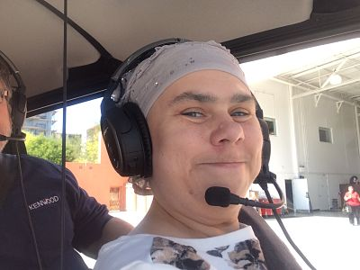 Helicopter ride with Bruce Haffner.  Headset on, ready for take off.  Have a nice flight, dear Cassie.